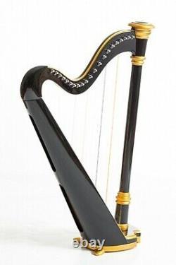 Harp 21 strings. Hand painted. Gold edging. Black. Vintage technology. Capris